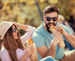 Happy Couple Eating Subs